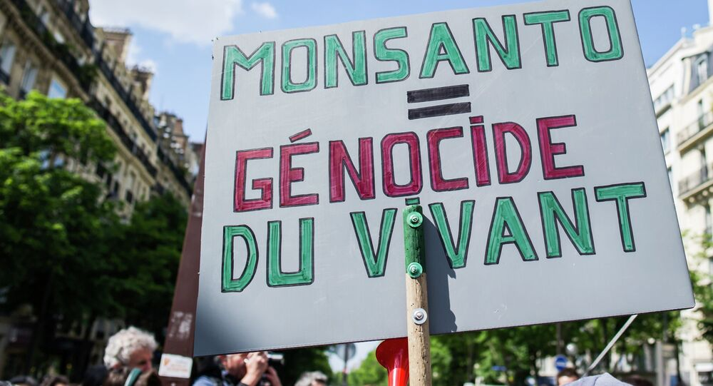 A banner is photographed, during a World March Against Monsanto, in Paris, France, in Paris, Saturday, May 23 2015