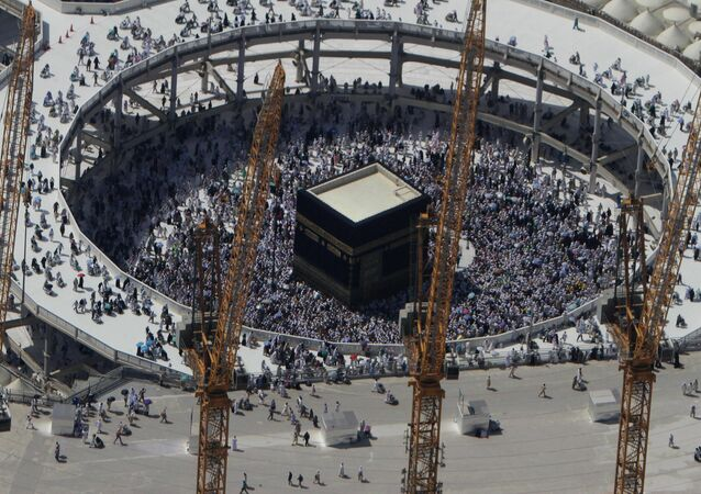 Cranes rise at the site of an expansion to the Grand Mosque as Muslim pilgrims circle counterclockwise around the Kaaba at the Grand Mosque in Mecca, Saudi Arabia, Wednesday, Oct. 16, 2013