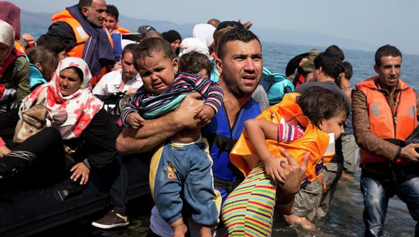 Syrian refugees arrive aboard a dinghy after crossing from Turkey to the island of Lesbos, Greece, Thursday, Sept. 10, 2015. The US is making plans to accept 10,000 Syrian refugees in the coming budget year - Sputnik International