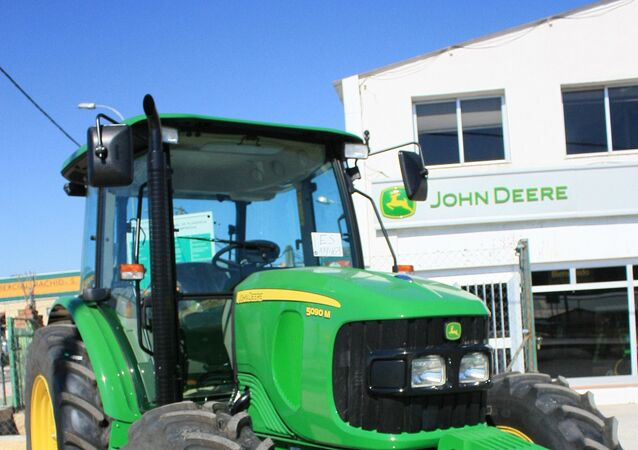 The US corporation John Deere is determined to continue cooperating with customers in Russia amid western sanctions imposed on Moscow over the crisis in Ukraine