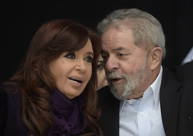 Argentine President Cristina Fernandez de Kirchner (L) listens to Brazilian former President (2003-2011) Luiz Inacio Lula da Silva as Buenos Aires governor and Argentine presidential candidate for the ruling Front For Victory (FPV) party Daniel Scioli (not in frame) delivers a speech in Buenos Aires outskirts on September 9, 2015