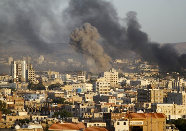Smoke billows from a Houthi-controlled military base after a Saudi-led air strike hit its weapons depots in Yemen's capital Sanaa September 12, 2015