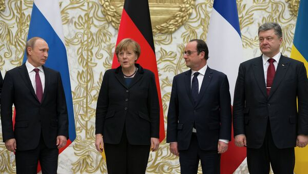 From the left : Russian President Vladimir Putin, German Chancellor Angela Merkel, French President Francois Hollande, and Ukrainian President Petro Poroshenko pose for a photo during a time-break in their peace talks in Minsk, Belarus, Wednesday, Feb. 11, 2015. Leaders of Russia, Ukraine, France and Germany are gathering for crucial talks in the hope of negotiating an end fighting between Russia-backed separatist and government forces in eastern Ukraine. - Sputnik International