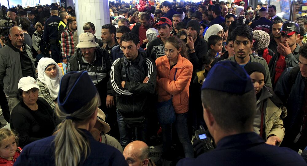 Migrants, who mostly crossed into the country from Serbia and are hoping to make their way to Austria, wait for trains heading to Hegyeshalom or Gyor, in a transit area at Keleti station in Budapest, Hungary, September 12, 2015