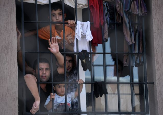 Refugees behind a barred window at Bulgaria's shelter for clandestine migrants near Lyubimets (File)