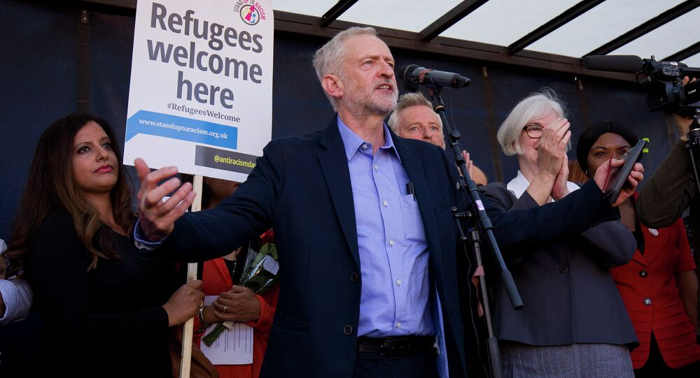 Newly elected leader of Britain's opposition Labour party, Jeremy Corbyn (C), addresses a rally pro-refugee rally in central London on September 12, 2015