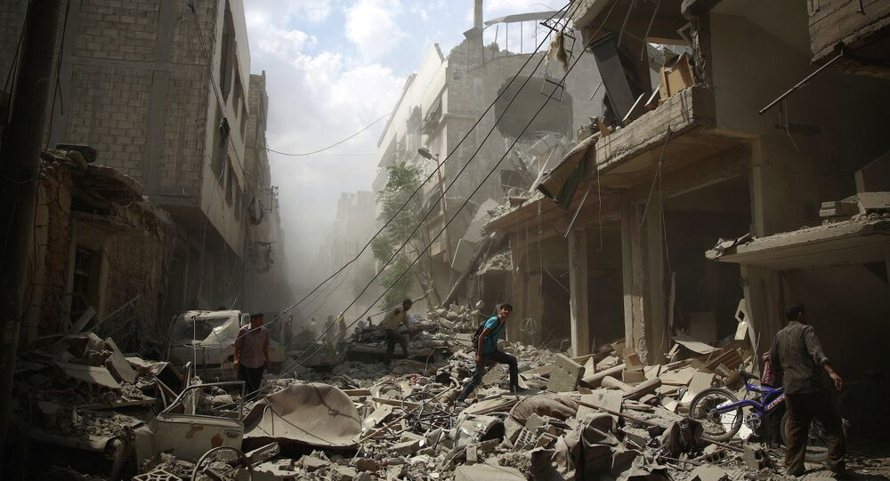 Syrians walk amid the rubble of destroyed buildings following reported air strikes by regime forces in the rebel-held area of Douma, east of the capital Damascus, on August 30, 2015