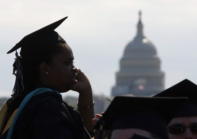 With the US Capitol as a backdrop, George Washington University students gather for their commencement ceremony on the National Mall in Washington