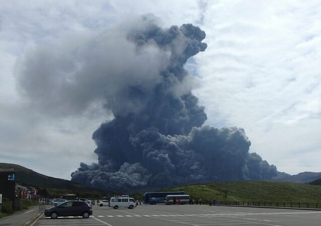 In this photo released by Aso Volcano Museum, a column of black smoke rises from Mount Aso on the southern Japanese island of Kyushu Monday, Sept. 14, 2015