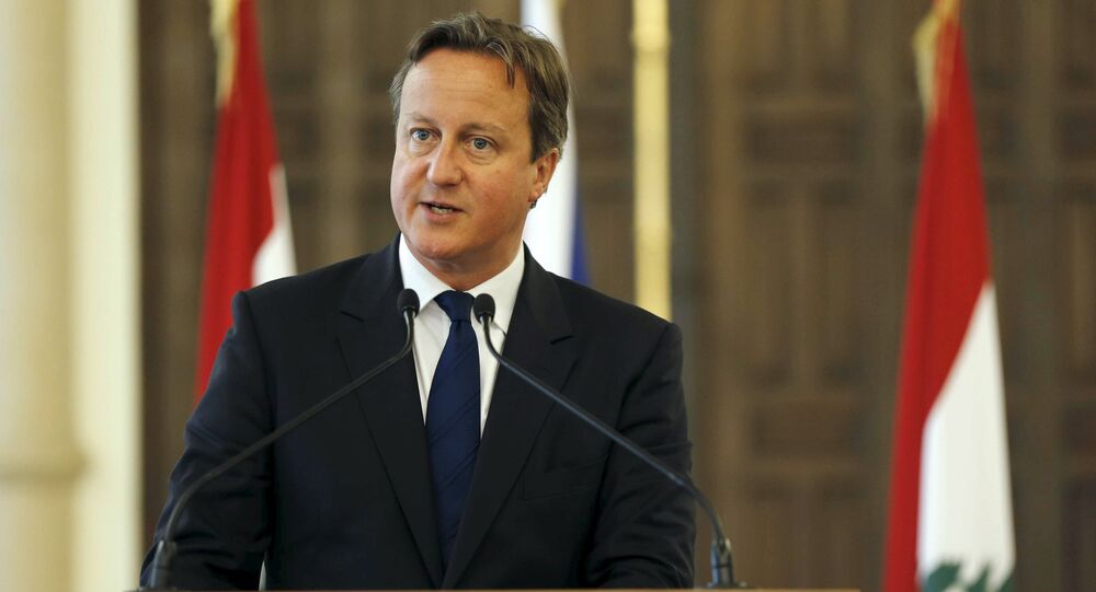British Prime Minister David Cameron talks at a news conference during his visit at the government palace in downtown Beirut, Lebanon September 14, 2015