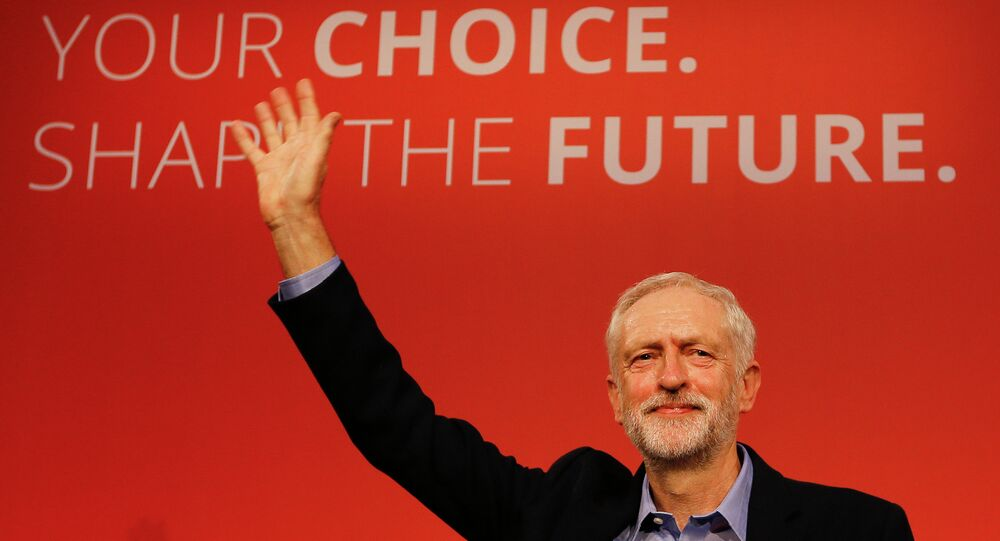 Jeremy Corbyn waves on stage after new is announced as the new leader of The Labour Party during the Labour Party Leadership Conference in London, Saturday, Sept. 12, 2015. Corbyn will now lead Britain's main opposition party.