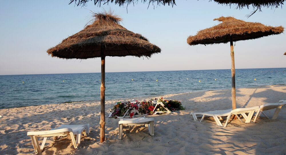 Lounge chairs and numerous flowers laid out at the scene of the attack in Sousse, Tunisia, Sunday, June 28, 2015