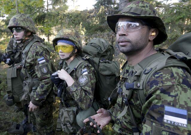 Estonia's Defence League volunteer soldiers attend training drill near Rabasaare, Estonia, September 12, 2015
