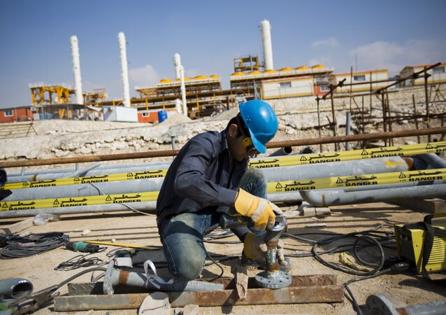 An Iranian man works at the phase 19 of the South Pars gas field facilities near the southern town of Kangan on the shore of the Gulf on January 22, 2014