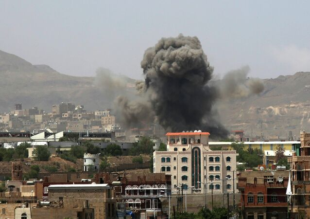 Smoke rises after a Saudi-led airstrike hits an army base in Sanaa, Yemen, Monday, Sept. 14, 2015
