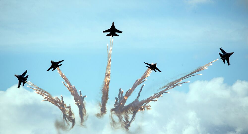 Su-27 jets of aerobatics team Russkiye Vityasy, or Russian Knights, perform during the MAKS-2015 International Aviation and Space Show in Zhukovsky, outside Moscow, Russia, Sunday, Aug. 30, 2015.