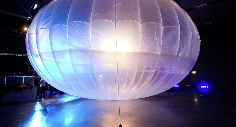 A high altitude WiFi internet hub Google Project Loon balloon is displayed at the Airforce Museum in Christchurch on June 16, 2013