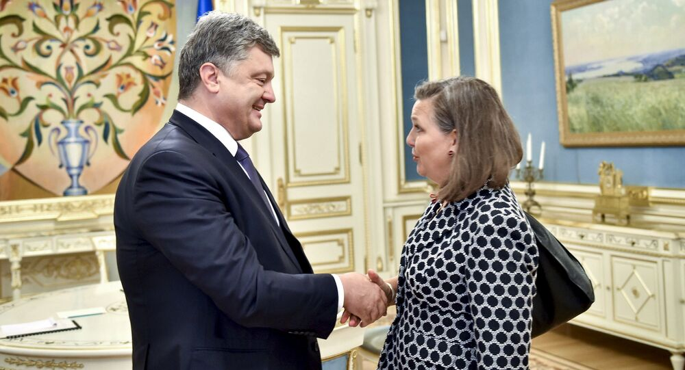Ukrainian President Petro Poroshenko (L) greets U.S. Assistant Secretary of State for European and Eurasian Affairs Victoria Nuland during a meeting in Kiev, Ukraine