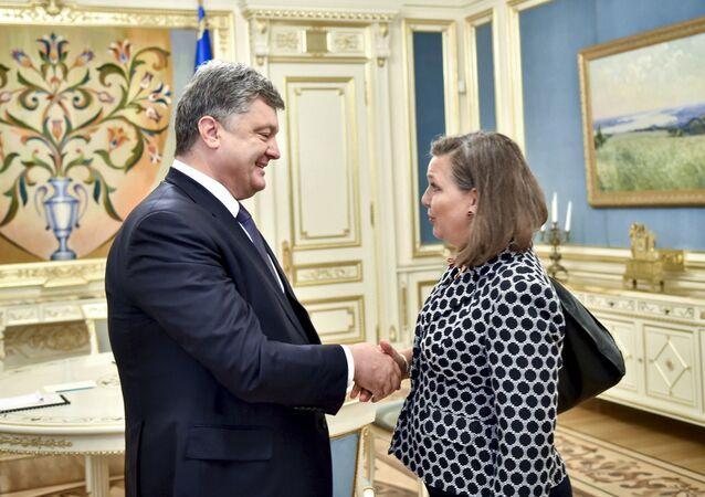 Ukrainian President Petro Poroshenko (L) greets U.S. Assistant Secretary of State for European and Eurasian Affairs Victoria Nuland during a meeting in Kiev, Ukraine