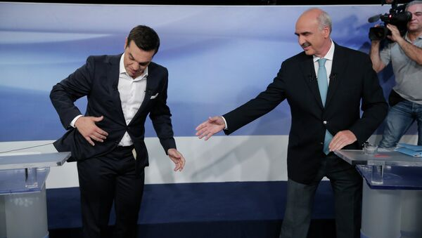 Former Greek Prime Minister Alexis Tsipras, left, and the leader of the left-wing Syriza party, is blocked by microphone wiring as he tries to approach main opposition conservative New Democracy head Vangelis Meimarakis, right, to shake hands prior to a live televised debate at the state-run ERT television in Athens, Monday, Sept. 14, 2015. Greece is holding a snap general election on Sept. 20, 2015. - Sputnik International