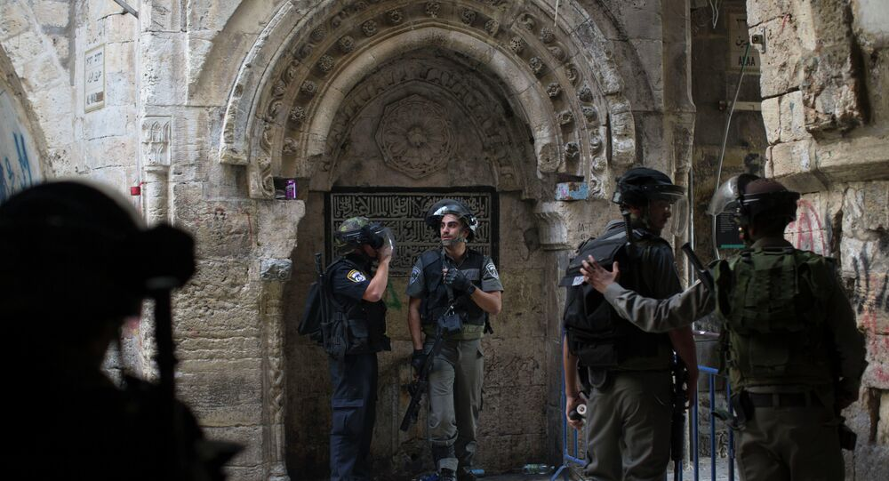 Israeli border police officers stand during clashes with Palestinian protesters in Jerusalem's old city, Tuesday, Sept. 15, 2015, in a third straight day of unrest at Jerusalem's most sensitive holy site.