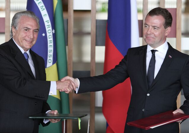 Russian Prime Minister Dmitry Medvedev (right) and Brazilian Vice President Michel Miguel Elias Temer Lulia. (File)