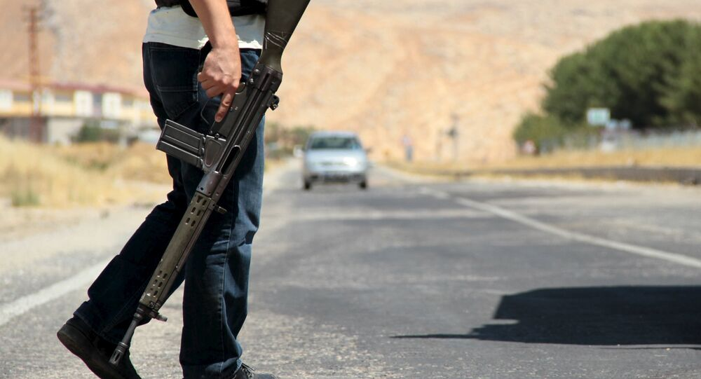 A member of the Turkish security forces stands guard at a check point on the main road to southeastern town of Silvan, near Diyarbakir.