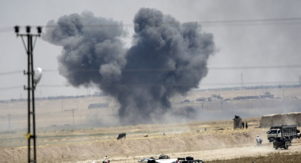 Black smoke billowing into sky after an airstrike.