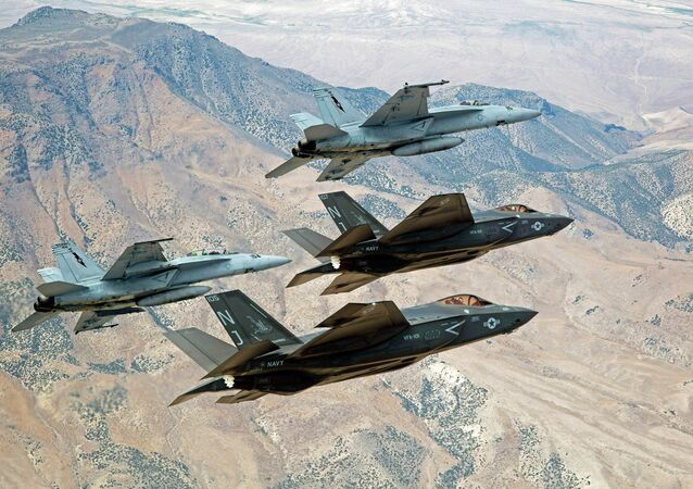 Two F-35s fly with a pair of Boeing super hornets over Nevada.