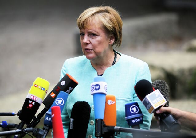 German Chancellor Angela Merkel, speaks to media after a visit of a so called 'Welcome Class', a special school class for migrants and refugees at the Ferdinand-Freiligrath school in Berlin, Germany, Thursday, Sept. 10, 2015.