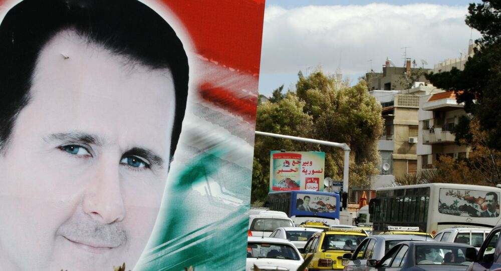 Banner bearing a portrait of Syrian President Bashar al-Assad in a street in the city of Damascus