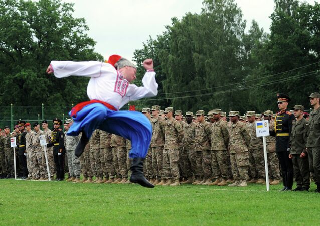 Ukrainian folk dancers perform for Ukrainian and US servicemen in a ceremony for joint-drill exercises between the two countries in Yavoriv polygon, Lviv district, western Ukraine