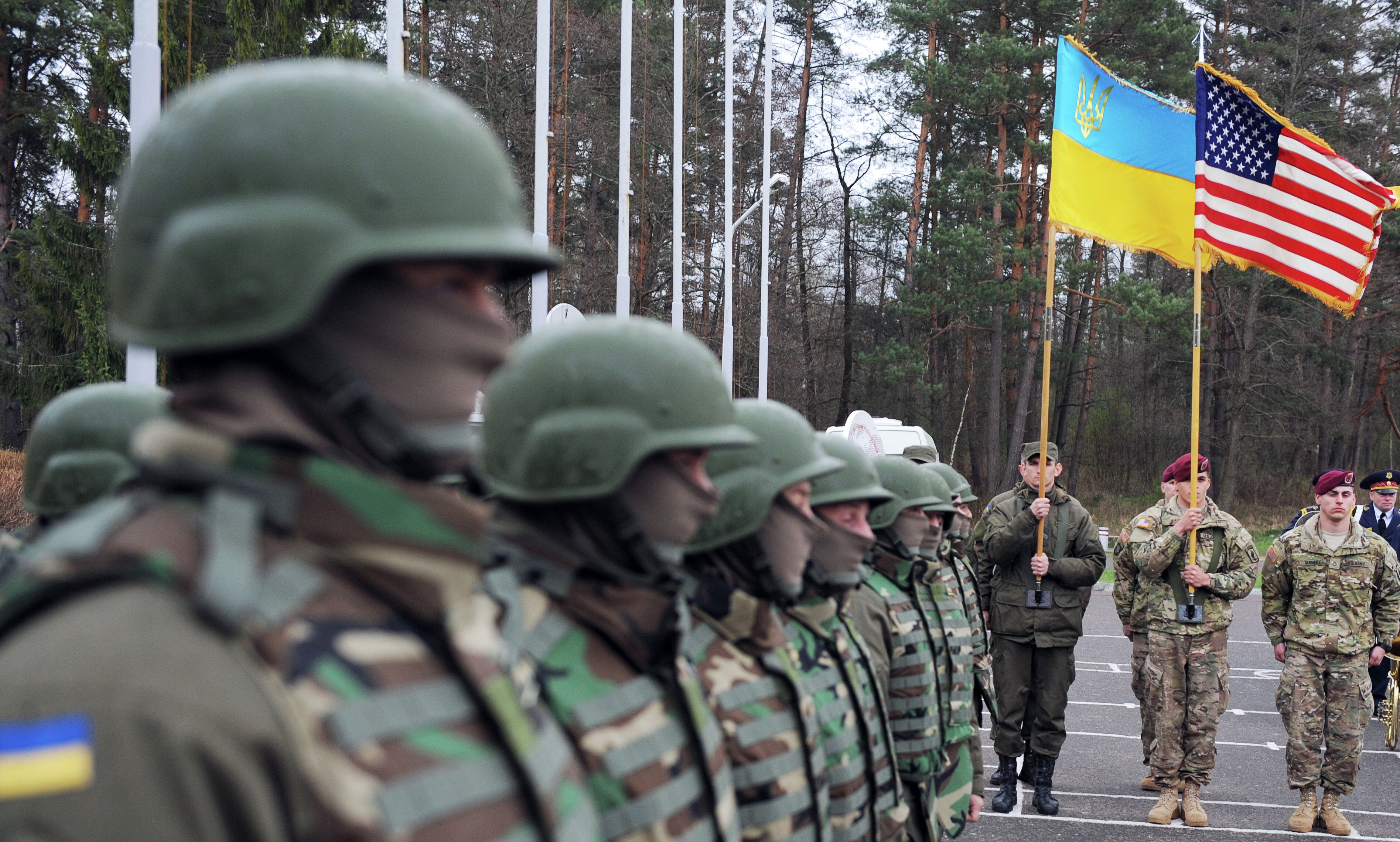 US and Ukrainian soldiers attend an opening ceremony of the joint Ukrainian-US military exercise 'Fearless Guardian' at the Yavoriv training ground