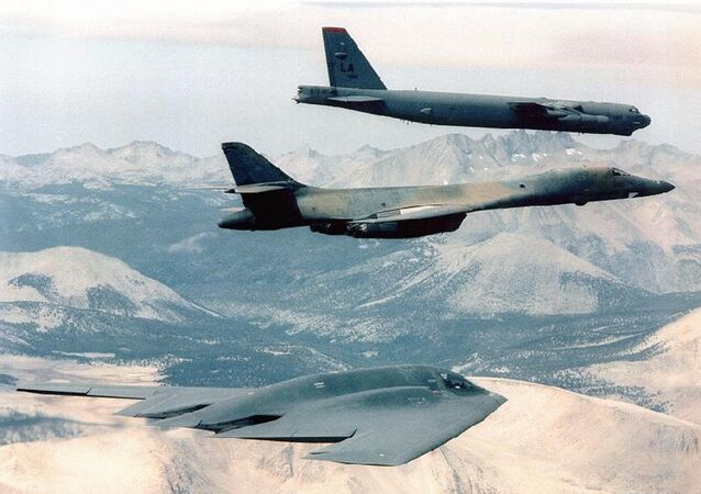 B-2 Spirit (bottom) bomber flying with B-1B (C) and B-52 bombers at an undisclosed location over Afghanistan, file photo.