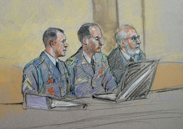 Army Sgt. Bowe Bergdahl, left, defense counsel Lt. Col. Franklin D. Rosenblatt, center, and lead defense counsel Eugene Fidell sit during a preliminary hearing to determine if Sgt. Bergdahl will be court-martialed.
