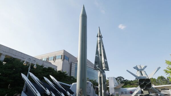 Visitors looks at models of North Korea's Scud-B missile, center left, and other South Korean missiles on display at the Korea War Memorial Museum in Seoul. - Sputnik International