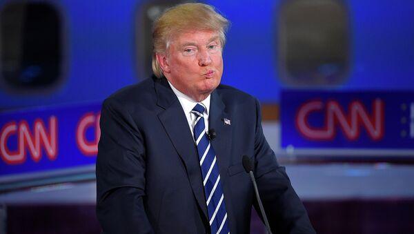Republican presidential candidate, businessman Donald Trump reacts during the CNN Republican presidential debate. - Sputnik International