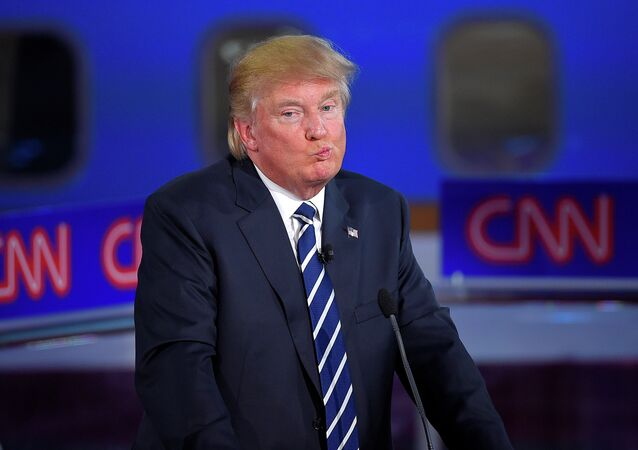 Republican presidential candidate, businessman Donald Trump reacts during the CNN Republican presidential debate.