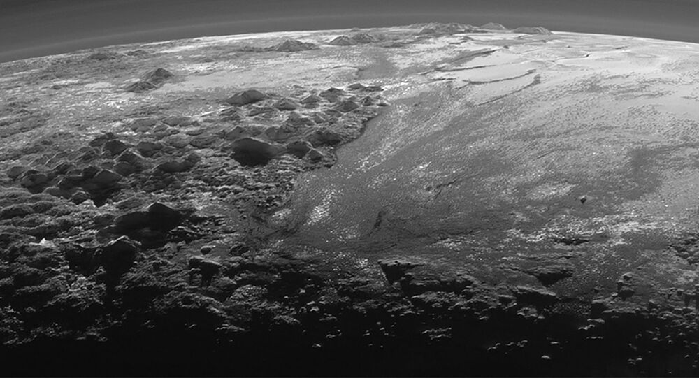 A close-up view of the rugged, icy mountains and flat ice plains on Pluto is seen in an image from NASA's New Horizons spacecraft