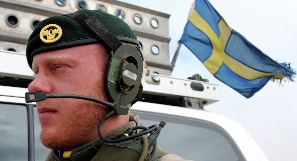 A Swedish soldier with the International Security Assistance Force patrols.