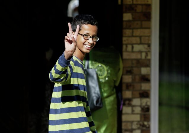 Ahmed Mohamed, 14, gestures as he arrives to his family's home in Irving, Texas, Thursday, Sept. 17, 2015