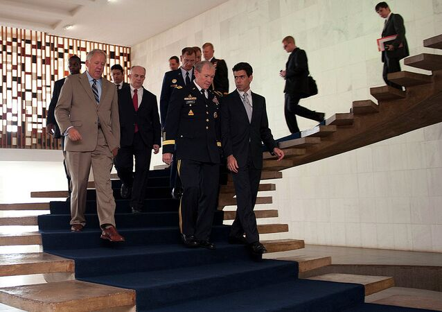 Army Gen. Martin E. Dempsey, center, chairman of the Joint Chiefs of Staff, walks with an aide to the Deputy Foreign Minster with Mr. Thomas A. Shannon, left, U.S. Ambassador to Brazil, continuing discussions on key issues Brazil continues to face on March 29, 2012 in Brasilia, Brazil.