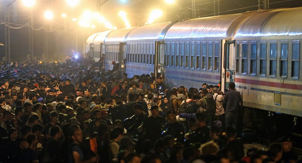 Migrants rush to board a train in the eastern-Croatia town of Tovarnik, close to the border between Croatia and Serbia on September 18, 2015
