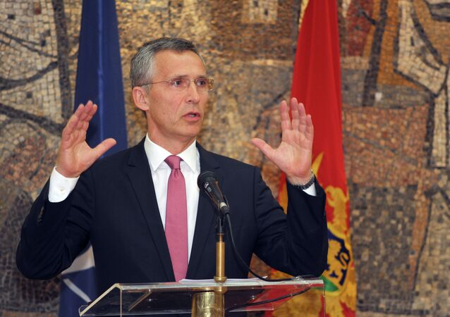 NATO Secretary-General Jens Stoltenberg speaks and gestures after talks with Montenegro's Prime Minister Milo Djukanovic, in Podgorica, Montenegro, Thursday, June 11, 2015
