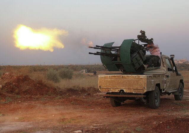 Rebel fighters fire a heavy machine gun during clashes with Syrian pro-government forces on the frontline facing Deir al-Zoghb, a government-held area in the northwestern Idlib province, on August 31, 2015