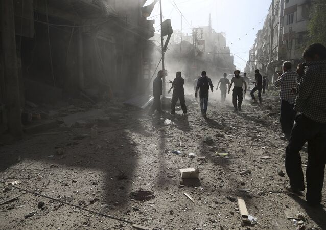 Residents inspect damage after what activists said was an airstrike by forces loyal to Syria's President Bashar al-Assad on the town of Douma, eastern Ghouta of Damascus September 19, 2015