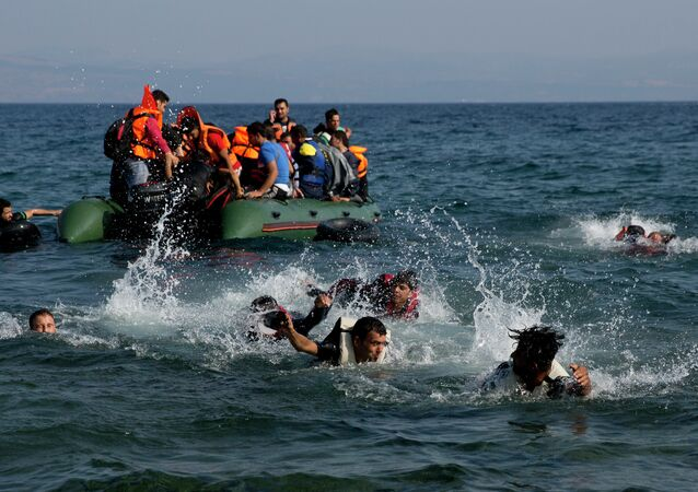 Migrant whose boat stalled at sea while crossing from Turkey to Greece swim to approach the shore of the island of Lesbos, Greece, on Sunday, Sept. 20, 2015.