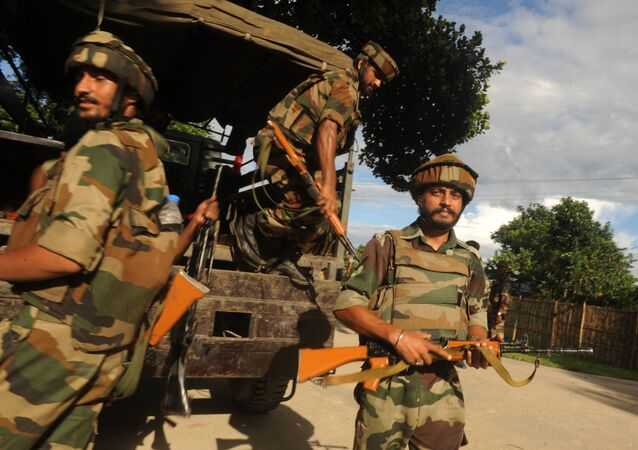 Indian army personnel unload from a truck at Ambadi village in Assam state's Kokrajhar district