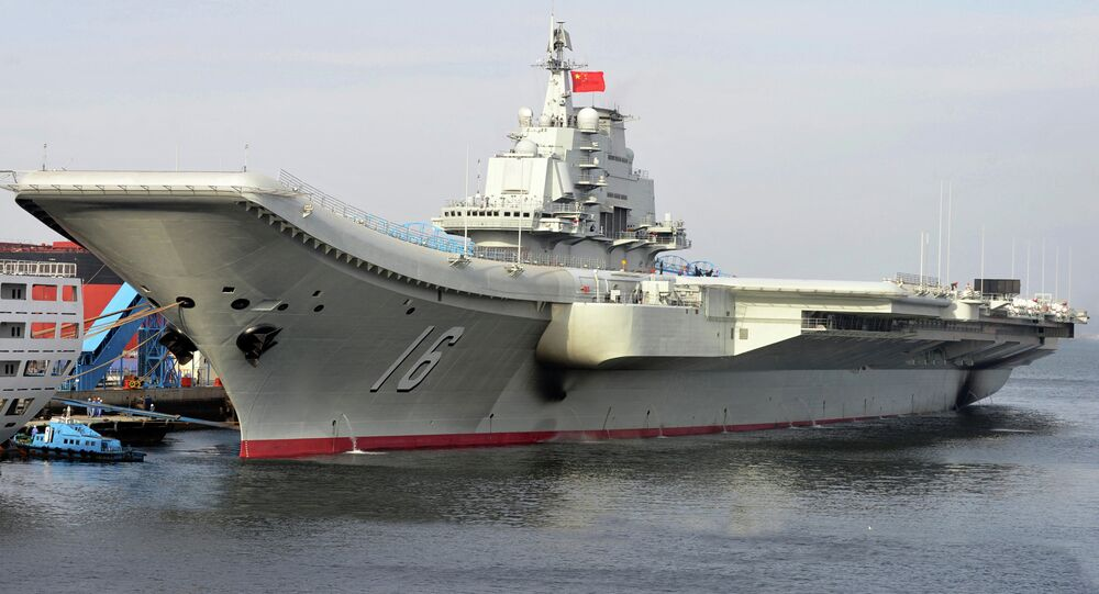 In this undated photo released by China's Xinhua News Agency, China's aircraft carrier Liaoning berths in a port of China. China formally entered its first aircraft carrier into service on Tuesday, Sept. 25, 2012