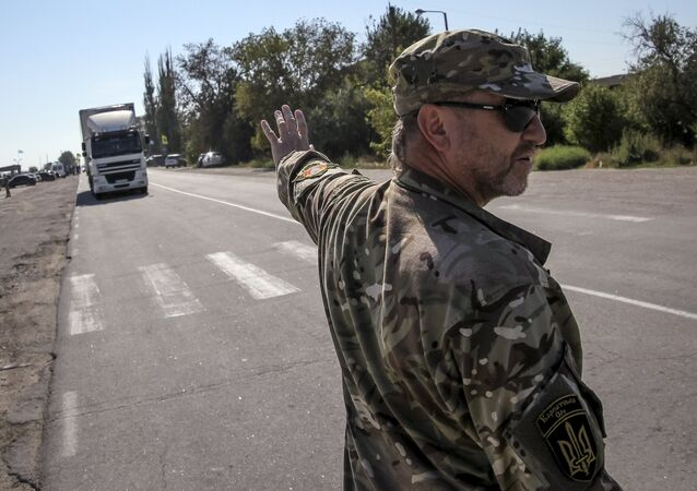 An activist stops a lorry near the village of Chongar, in the Kherson region adjacent to Crimea, Ukraine, September 20, 2015